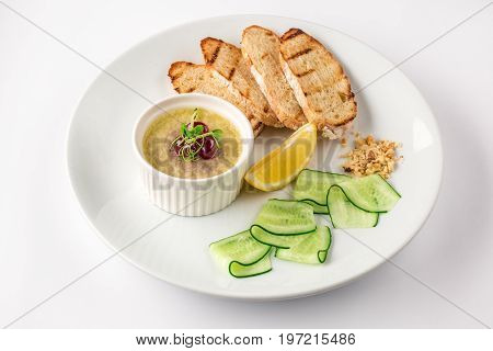 Liver pate. French pate. Sandwich with pate on a white plate. Top view on a white background