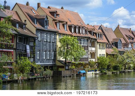 Old buildings architecture on Linker Regnitz river on April 26 2015 in Bamberg Germany.