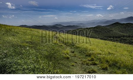 The Appalachian Trail as it runs across Max Patch Bald on the border of North Carolina and Tennessee.