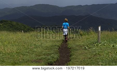A child hikes the Appalachian Trail as it runs across Max Patch Bald at the Tennessee and North Carolina state lines