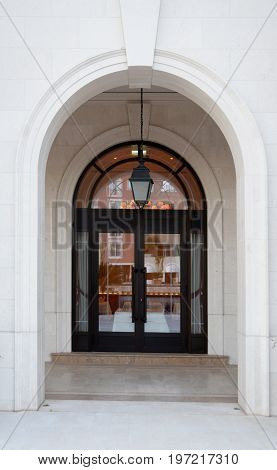 Arch hall and glass doors at the entrance to the luxury building