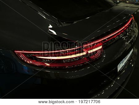 Sankt-Petersburg Russia July 21 2017: Back view of a Porsche Panamera Turbo 2017. Rear light .Car exterior details. Photo Taken at Royal Auto Show July 21