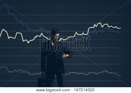 Businessman with briefcase standing over diagram background. Business, finance, investment concept.