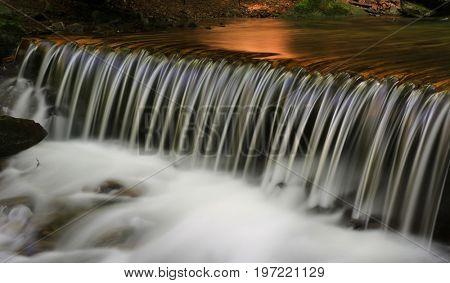 nice waterfall cascade on mountain river