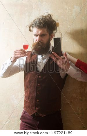 Hipster Holding Glass With Wine And Bottle On Female Hand