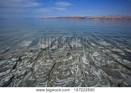 he Dead Sea also called the Salt Sea is a salt lake bordered by Jordan to the east and Israel and the West Bank to the west.