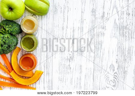 Preparing baby food. Broccoli, pumpkin, apple puree on light wooden table background top view.