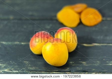 Fresh Apricot And Dried Apricots. Dark Wooden Background.