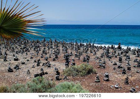 Cairn rock pebbles on Tenerife beach at Costa Adeje, Adeje, Tenerife Canary Islands, Spain