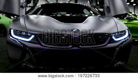 Sankt-Petersburg Russia July 21 2017: Luxury BMW i8 hybrid electric coupe. Plug-in hybrid sport car. Concept electric vehicle. Dark Matt color. Car exterior details. Photo Taken at Royal Auto Show July 21
