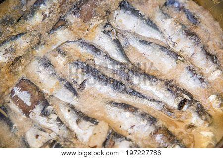 Sardines being prepared with sea salt and herbs - Cefalu Food Market - Sicily Italy