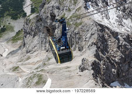 Top view of cable car in Austrian Alps mountains