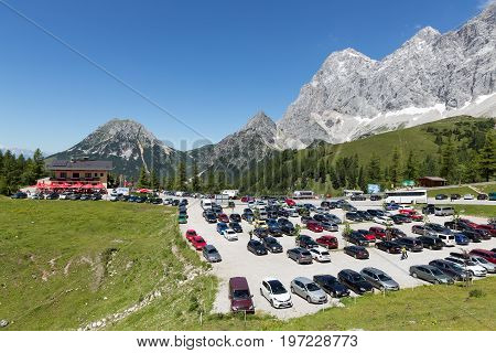 DACHSTEIN MOUNTAINS AUSTRIA - JULY 17 2017: Car park near the valley station of the Dachstein glacier cable car in Austria