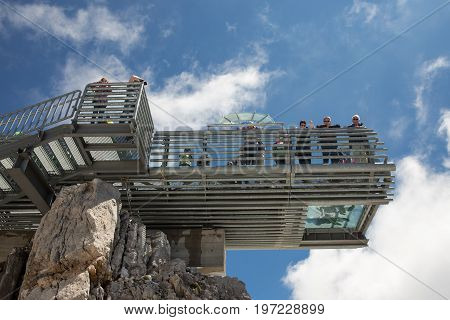 DACHSTEIN MOUNTAINS AUSTRIA - JULY 17 2017: Viewpoint at Austrian Dachstein mountain station with people admiring the view