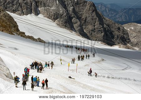 DACHSTEIN MOUNTAINS AUSTRIA - JULY 17 2017: Dachstein Mountain in Austria with hikers at the glacier