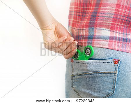Girl holding a colourful hand fidget spinner toy.