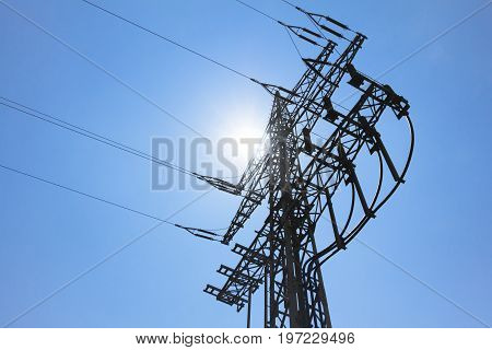 High-tension power line tower carry green sun electricity energy. Ironman business is transmission of renewable sustainable power to prevent climate change and heal the world. Important modernization of grid.