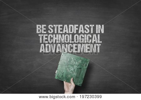 Cropped image of businessman holding circuit board under be steadfast in technological advancement text on blackboard