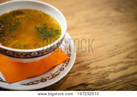 Chicken soup with handmade noodles on chicken broth with seasonings and vegetables.