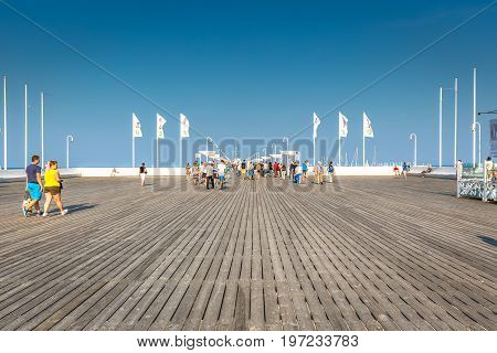 SopotPoland-September 72016:Tourists walking on the Sopot Pier longest wooden pier in Europe