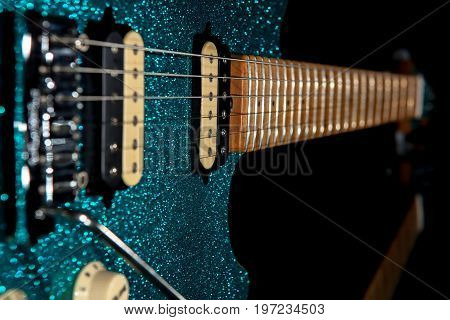 Glam rock guitar. Stunning electric guitar with beautiful glitter finish. Loud christmas party music image.