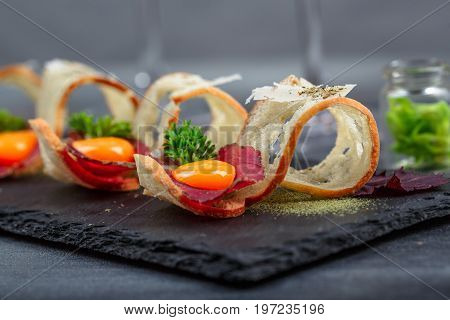 Tapas on Crusty Bread - Selection of Spanish tapas served with a sliced baguette