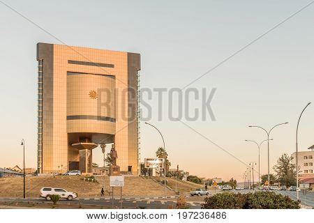 WINDHOEK NAMIBIA - JUNE 16 2017: A street scene with the Independence Memorial at sunset in Windhoek the capital city of Namibia