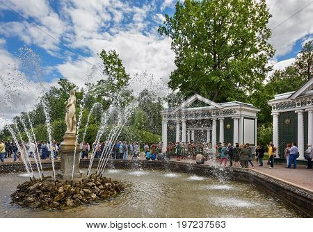 PETERHOF/ RUSSIA - JULY 2, 2017. Vintage orchestra playing next to the fountain Eva in the lower Park of Peterhof. Sankt Petersburg, Russia.