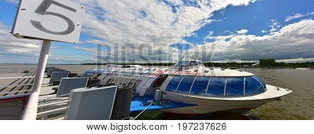 PETERHOF/ RUSSIA - JULY 2, 2017.  Passenger mooring Peterhof for hydrofoil boats, of the type Meteor, located at the open coast of Gulf of Finland, in Petergof (suburb of St. Petersburg), Russia