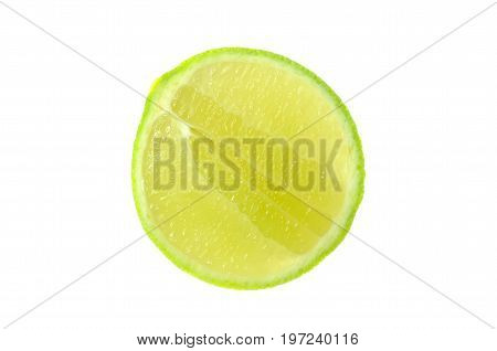 Isolate longitudinal section green lime a close up photo image of a longitudinal slice green lime isolate on bright white light back ground present a detail of surface on longitudinal section of lime