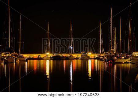 Night shot of the small marina of Punta Ala in Tuscany Italy long exposure.
