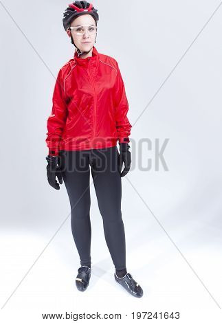Sport Concepts and Ideas. Portrait of Caucasian Female Cycling Athlete Posing Equipped in Professional Outfit in Studio.Vertical Image