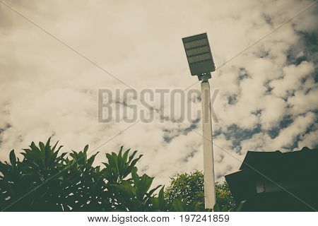 Lamp Post Electricity Industry With Blue Sky Background And Tree. Spotlight Tower, Vintage Tone.