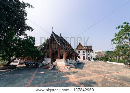 LUANG PRABANG LAOS - MARCH 11 2017: Small temple inside monks' village close to Wat Xieng Thong located in the city Luang Prabang Laos