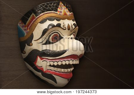 Puppet mask of the Mahabharata and Ramayana white-faced monkeys or Hanoman, made of wood as a complement to the art of the puppet show.