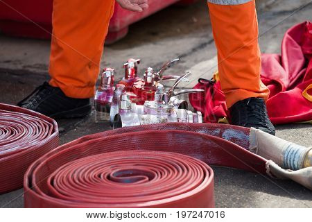 Rolled Into A Roll Red Fire Hose, Fire Equipment Extinguishers Ready To Use In The Outdoor