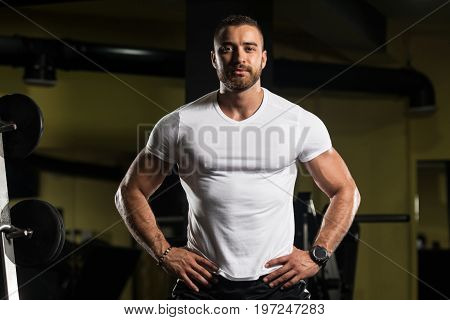 Portrait Of A Fitness Man In White Shirt