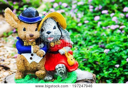 Mr and Mrs Rabbit Garden Ornament arm in arm