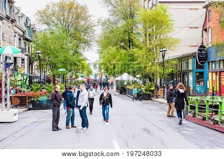 Montreal Canada - May 26 2017: People walking on Saint Denis street in Montreal's Plateau Mont Royal in Quebec region