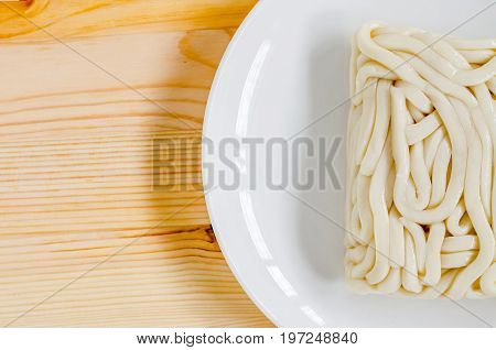 White Udon Noodle In White Dish On Wooden Background