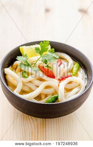 Close Up Hot And Spicy Udon Noodle On Wooden Background