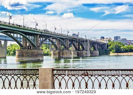The river Ob Novosibirsk Siberia Russia - July 17 2017 October ( Utilities ) bridge and Michaylovskaya the waterfront