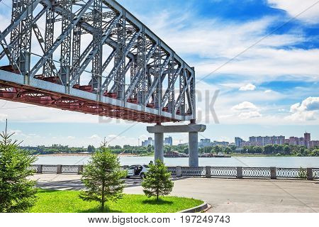 Novosibirsk Siberia Russia - July 17 2017: construction of the first Span of the railway bridge over the Ob river ( Built in 1893-1897 on draft N. A. Belloustogo ) on the waterfront in the Park City home