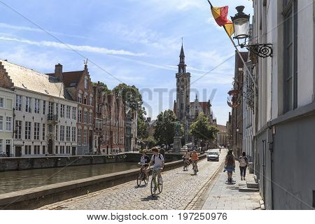 Bruges, Belgium - July 7, 2017: Tourists Riding Bikes On The Streets Of Bruges, Flanders In Belgium