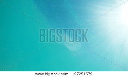 Underwater view of the surface during a bright sunny day. Nassau, Bahamas.
