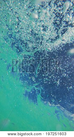Underwater view of the surface with bubbles during a bright sunny day. Nassau, Bahamas.