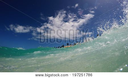 Tropical water wave near the beach during a bright day in the tropics. Nassau, Bahamas.