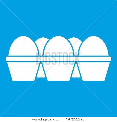 Eggs in carton package icon white isolated on blue background vector illustration