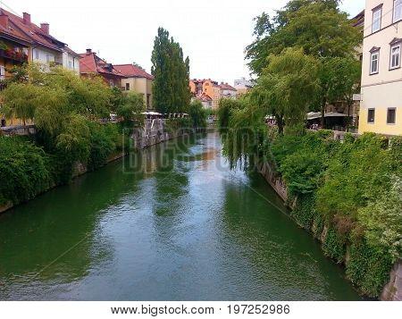 LJUBLJANA, SLOVENIA - JULY , 2014: Ljubljana -Slovenia - city centre, view on the river. Ljubljana is the business and cultural center of the country