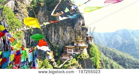 Taktshang Goemba or Tiger's nest monastery with colorful Tibetan prayer flags Paro Bhutan.
